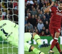 Free-scoring Liverpool make it into Champions League group stage