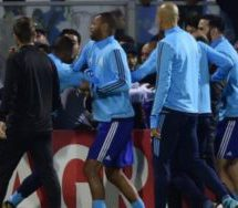 Evra sent off for kicking fan in warm-up
